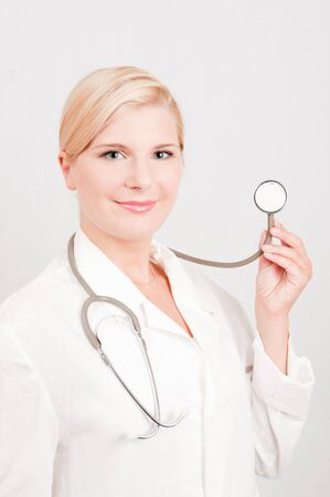 Beautiful female doctor in white medical uniform and stethoscope Stock Photo - 7722057