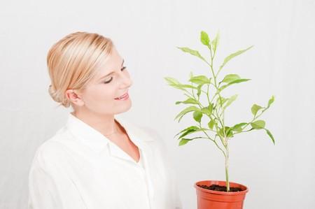 Beautiful female botanic scientist in white uniform and green plant Stock Photo - 7722296