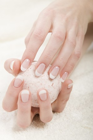 Beautiful hands with perfect french manicure and soap Stock Photo - 7722317