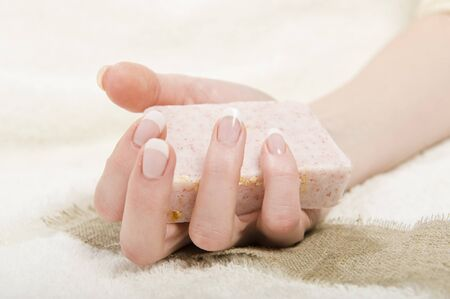 Beautiful hands with perfect french manicure and soap Stock Photo - 7722306
