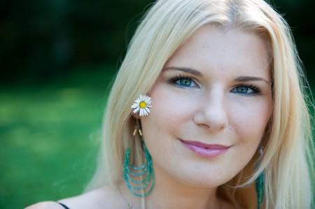 Beautiful fresh spring girl in green park photo