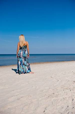 Beautiful summer woman walking on the beach Stock Photo - 7785760