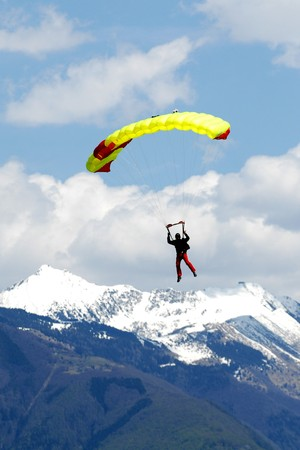 parachute jump: Extreem sports. parachuting under a blue sky Stock Photo