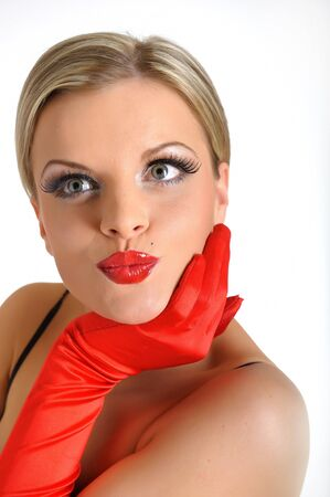 Young elegant beauty female face with red shiny lips and black eye makeup. colse-up. photo