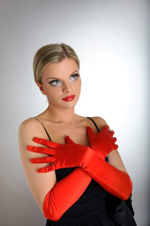 Portrait of sexy fashion woman with red lips and gloves looking up. white background photo