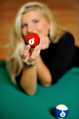 beautiful woman holding a billiard ball  photo