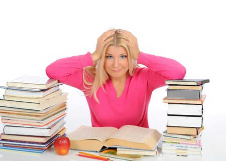 portrait of young  student girl with lots of books in panic. isolated on white background photo