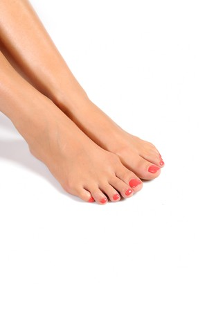 Beautiful feet leg with perfect spa pedicure on bright pink nails. white background Stock Photo - 7722482