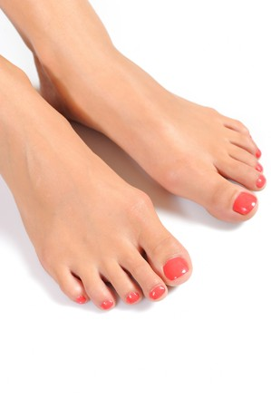 Beautiful feet leg with perfect spa pedicure on bright pink nails. white background Stock Photo - 7785710