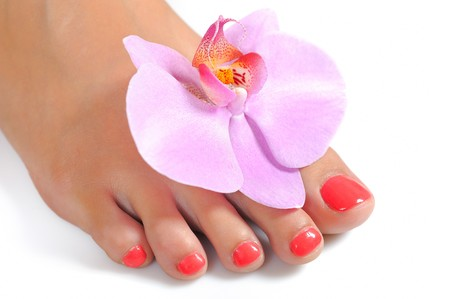 Beautiful feet leg with perfect spa pedicure on bright pink nails. white background