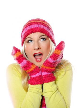 Seasonal portrait of pretty funny woman in hat and gloves screaming photo