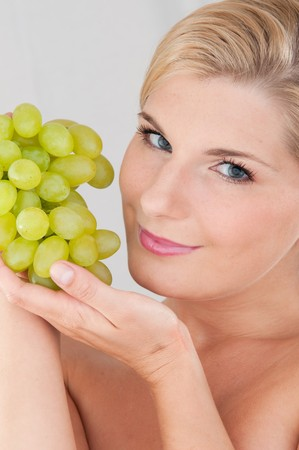 beautiful fresh spa woman with bunch of grapes photo