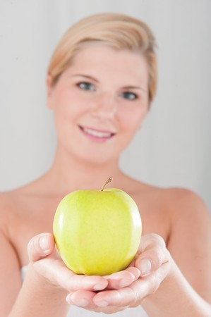beautiful fresh spa woman with green apple photo