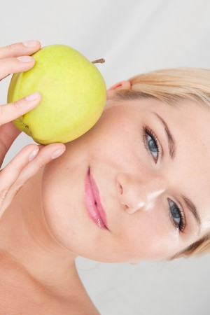 beautiful fresh spa woman with green apple Stock Photo - 7722430