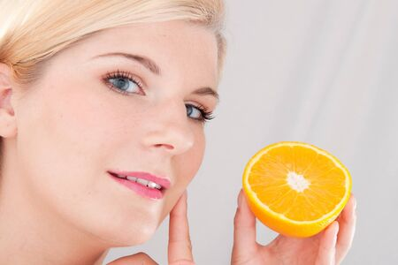 beautiful fresh spa woman with citrus orange fruit photo