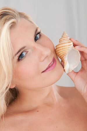 beautiful fresh spa woman with healthy pure skin and sea shell photo