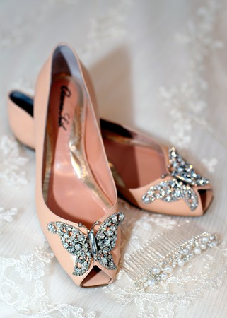 Beautiful luxury white wedding shoes with pearl necklace photo