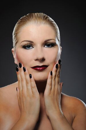 pretty woman with bright make-up and dark manicure photo