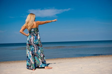 Pretty summer woman in a dress on a beach Stock Photo - 7874147