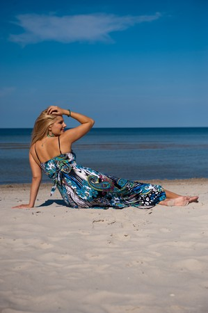 Pretty summer woman in a dress on a beach Stock Photo - 7874115