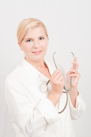 pretty female doctor with medical stethoscope photo