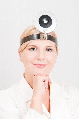 pretty female doctor with medical tool photo