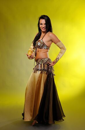 Beautiful sexy dancer woman in bellydance costume with pretty professional stage make-up photo