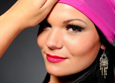 stage makeup: Bella donna sexy con palco professional make-up e orecchini