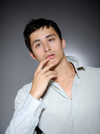 Expressions. Handsome man in white shirt feeling sad and depressed Stock Photo - 7874174
