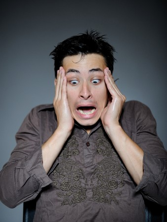 Expressions. Handsome man is terrified and feeling fear . open mouth Stock Photo - 7874208