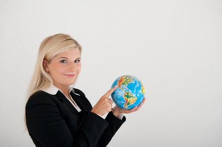 online internet presence: beautiful business woman in a suit  with globe