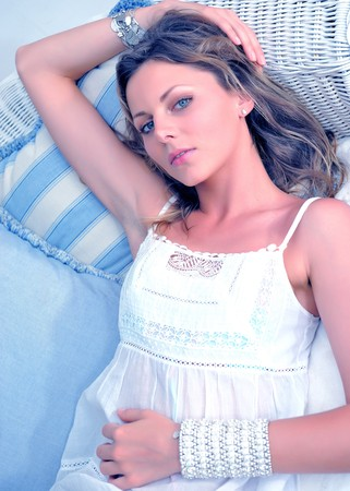 portrait of Young pretty woman relaxing on a sofa in her home Stock Photo - 7874188