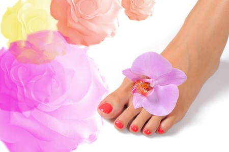 Beautiful feet leg with perfect spa pedicure on bright pink nails. white background Stock Photo - 7880435