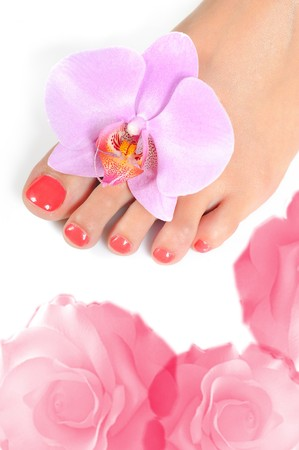 Beautiful feet leg with perfect spa pedicure on bright pink nails. white background photo