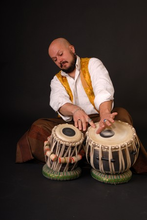 Musician with oriental tabla drums photo