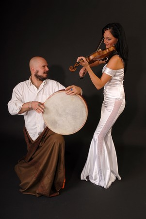 Two Musician with oriental drum instrument and violin photo