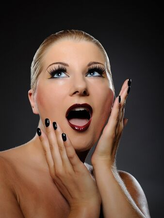 Emotional pretty woman face with bright make-up and violet lipstick screaming  photo