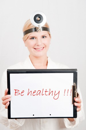 Beautiful female doctor giving health tips - be healthy text photo
