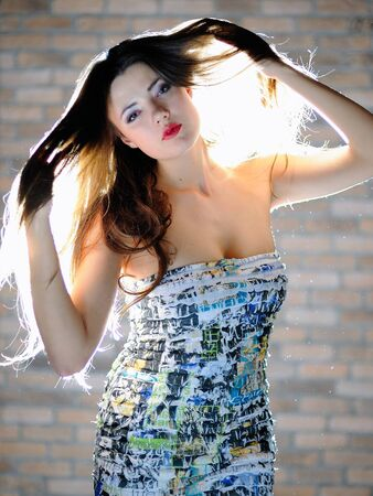 Young sexy woman with long healthy hair and bright  make-up dancing photo