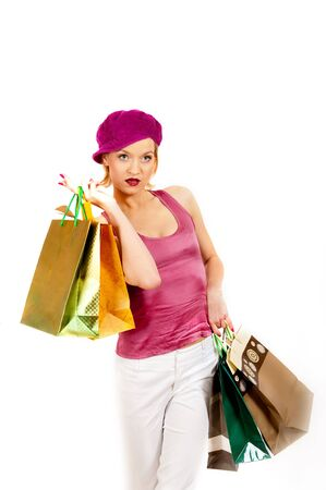 Young sexy shopping girl with lots of colourfull bags. isolated an white background Stock Photo - 7874261