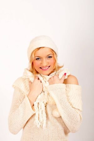 beautiful winter woman in warm clothes and scarf photo