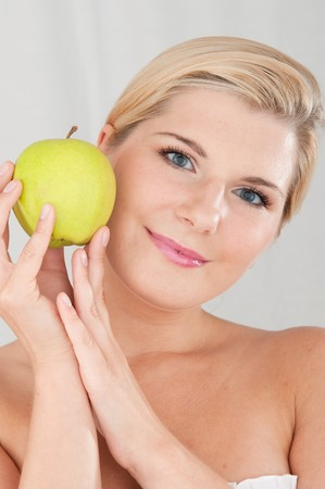 Beautiful fresh woman with green apple smiling photo