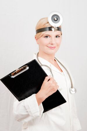 Young female doctor with stethoscope photo