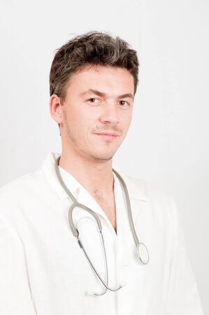 Young male doctor with stethoscope photo