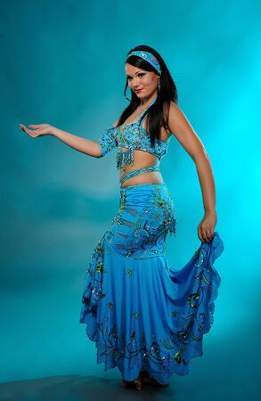 bellydance: Beautiful sexy dancer woman in bellydance costume with pretty professional stage make-up