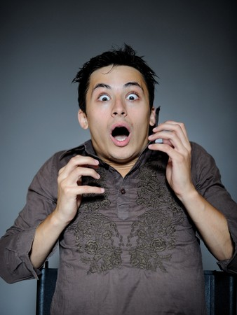 unexpectedness: Expressions. Handsome man is terrified and feeling fear . open mouth