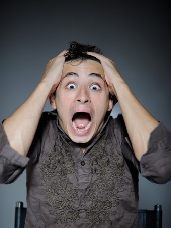 Expressions. Handsome man is terrified and feeling fear . open mouth Stock Photo - 7886987