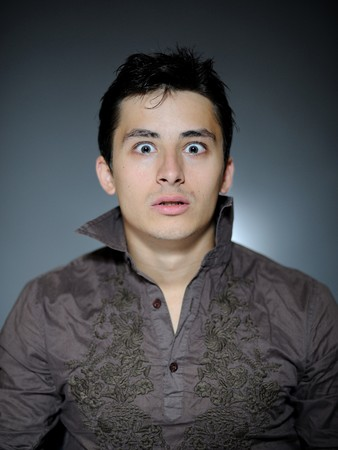 Expressions. Handsome man is terrified and feeling fear . open mouth Stock Photo - 7886979