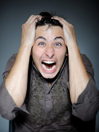 Expressions. Handsome young man feeling fear and pain Stock Photo - 7886978