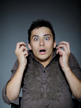 Expressions. Handsome young man feeling fear with open mouth Stock Photo - 7886991